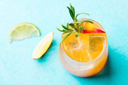 Peach cocktail, fizz, ice tea lime. Top view.