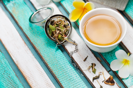 Herbal green tea in white cup. Copy space. Stock Photo