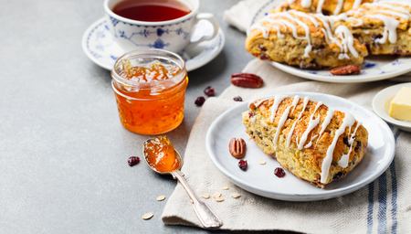 Scones with oats, cranberry and pecan nuts. Copy space Stock Photo