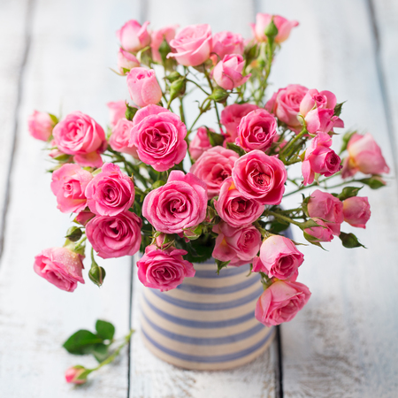 Rose flowers in vase. Beautiful romantic bouquet. Copy space