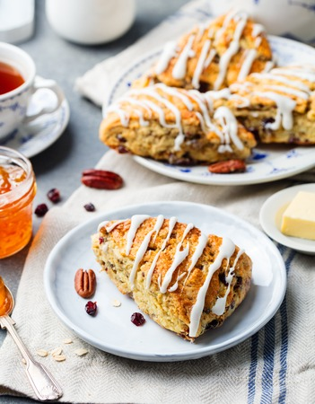 Scones with oats, cranberry and pecan nuts.