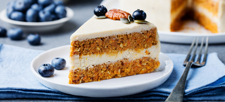Vegan, raw carrot cake on a white plate. Healthy food