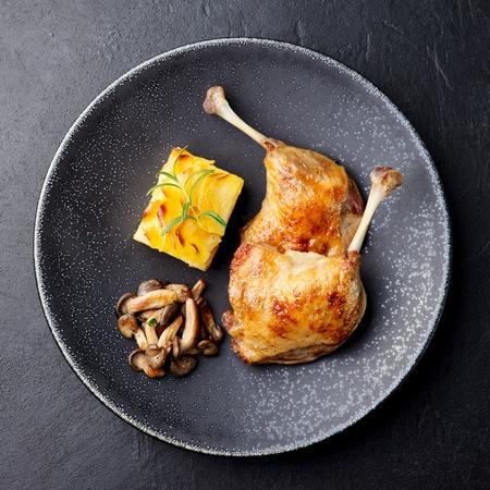 Duck legs confit with potato gratin and mushroom sauce. Restaurant serving Stok Fotoğraf