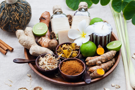 Spa, heath care set of essential oils, soap, ginger, turmeric roots and spices on a wooden tray 写真素材 - 95973623