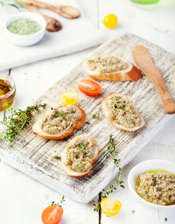 Bruschetta with green olives paste, tapenade