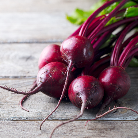 Fresh organic beet, beetroot on grey rustic wooden background
