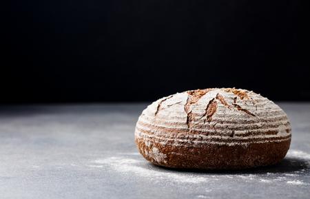 Bread rye, whole grain on a grey slate background. Copy space