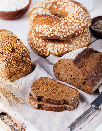Fresh bread assortment on a textile background. Rustic background