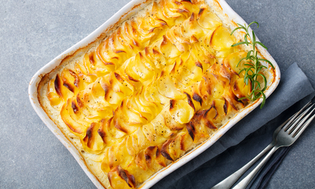 Potato gratin, backed potato slices with creamy sauce. Top view
