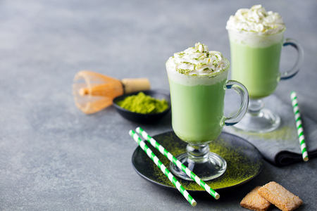 Matcha green tea latte with whipped cream. Copy space