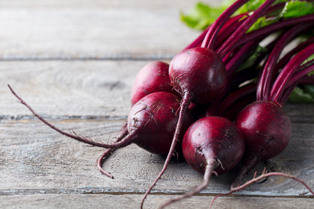 Fresh organic beet, beetroot on grey rustic wooden background. Copy space Banco de Imagens
