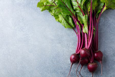 Beet, beetroot bunch on grey stone background. Copy space. Top view