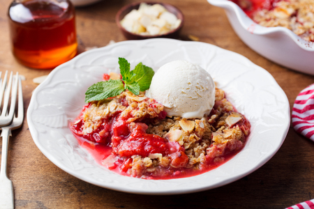 Crumble with berries and fruits with vanilla ice cream Stock Photo