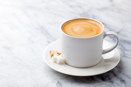 Coffee, espresso in white cup of marble table background. Copy space.