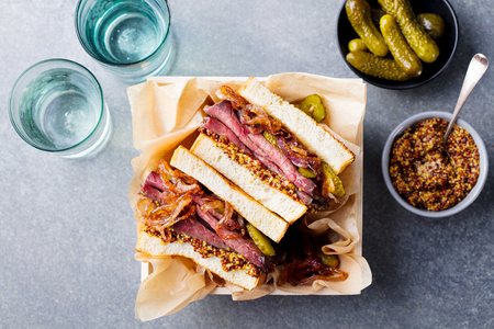 Sandwich with roast beef in wooden box. Top view. Stock Photo