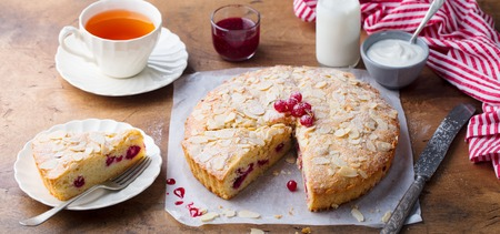 Almond and raspberry cake, Bakewell tart. Traditional British pastry. Wooden background