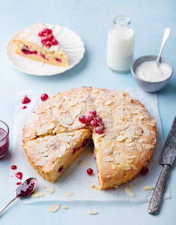 Almond and raspberry cake, Bakewell tart. Traditional British pie. Blue background