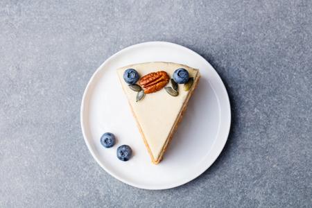 Vegan, raw carrot cake. Healthy food. Grey stone background. Top view Standard-Bild