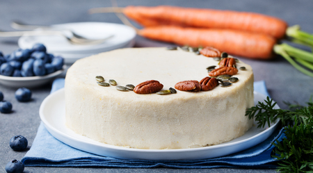 Vegan, raw carrot cake. Healthy food. Grey stone background. Close up