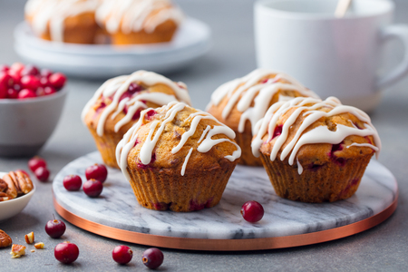 Muffins, cakes with cranberry and pecan nuts. Christmas decoration. Top view Stock Photo