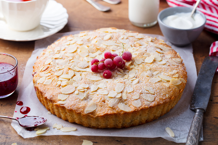 Almond and raspberry cake, Bakewell tart. Traditional British pastry. Wooden background. Close up.