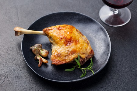 Duck legs confit with mushroom sauce . Restaurant serving. Close up Stock Photo