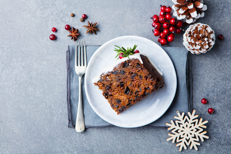 Christmas fruit cake, pudding on white plate. Copy space. Top view. Stock Photo - 109096144
