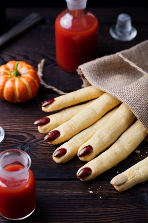 Halloween cookies Witchs fingers for party celebration. Wooden background. 写真素材