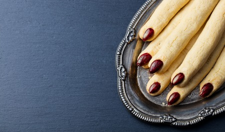Cookies Witchs fingers for Halloween party celebration. Slate background. Copy space. Top view. 写真素材