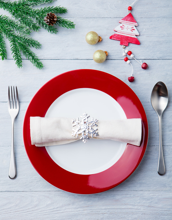 Christmas, New Year celebration place table setting. Wooden background. Top view. Stock Photo