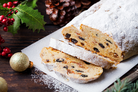 Christmas stollen. Traditional German festive dessert. Wooden background. Archivio Fotografico