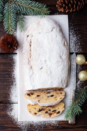 Christmas stollen cake with icing sugar. Traditional Dresdner christ pastry. Top view. Banco de Imagens - 111949773