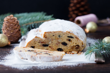 Christmas stollen cake with icing sugar. Traditional Dresdner christ pastry. Close up.