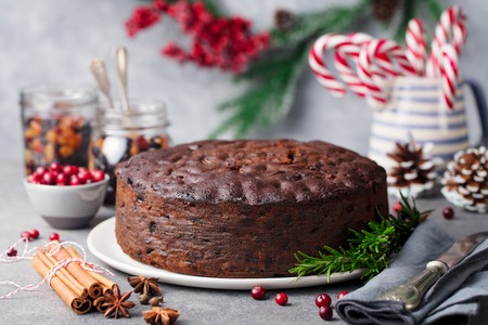 Christmas fruit cake, pudding on white plate. Copy space. Close up. Stock Photo