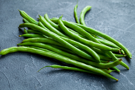 Green beans on grey stone background. Close up. Stock Photo