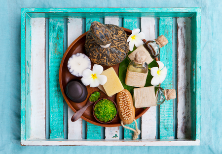 Spa and wellness massage setting. Colorful wooden background. Top view. Copy space.