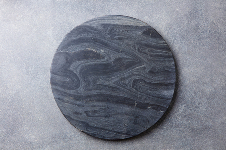 Black marble texture board on grey background. Top view. Copy space. Stock Photo
