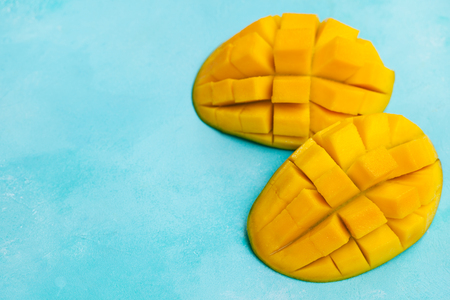 Fresh mango organic product. Blue background. Top view. Copy space.