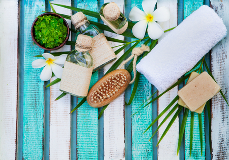 Spa and wellness massage setting. Still life with flower. Copy space. Top view.
