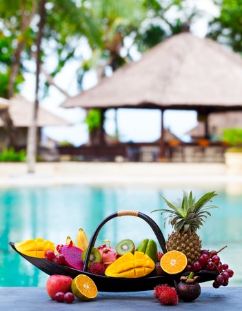 Tropical fruits assortment in wooden boat. Stock Photo