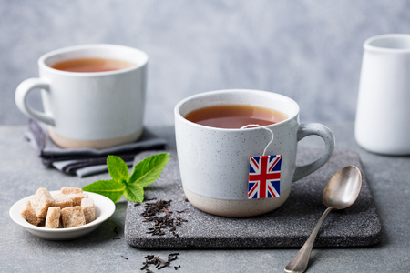 Tea in mugs with British flag tea bag label. 写真素材
