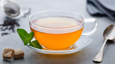 Tea cup with mint leaf.