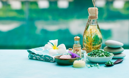 Spa and wellness massage setting. Still life with essential oil, salt and stones. Stock Photo