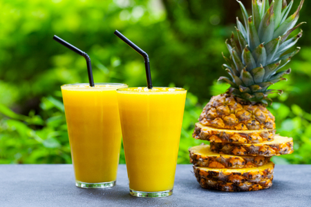 Pineapple with tropical fruit juice, smoothie on outdoor Stock Photo