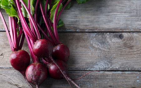 Beet, beetroot bunch on grey wooden