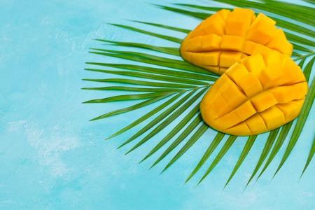 Fresh mango on a palm leaf. Stock Photo