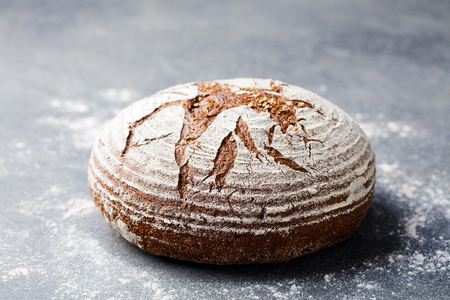 Bread rye, whole grain on a grey background. Copy space. Banco de Imagens