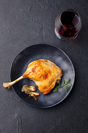 Duck legs confit with mushroom sauce. Top view. Stock Photo