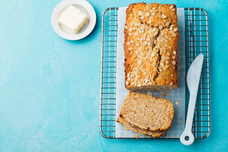 Healthy vegan oat, coconut loaf bread, cake on a cooling rack.
