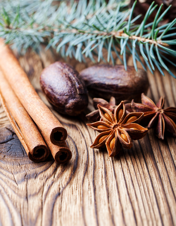 Spices and pine leaves on wooden